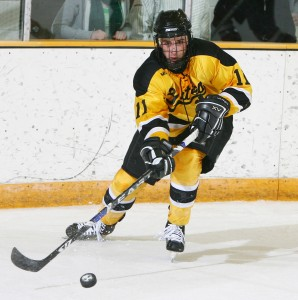 Senior forward Dave Martinson handles the puck during a home game last year. Sports Information.
