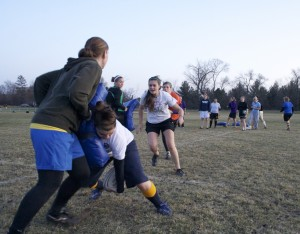 The Gustavus Women's Rugby team runs a drill during practice. Jake Seamans.