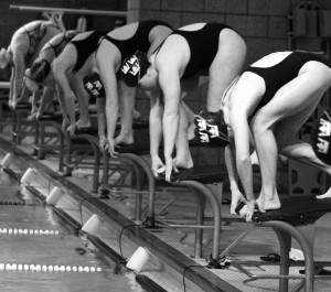 Gustavus Women's swimmers prepare to dive off the block in a recent meet.  Sports Information.