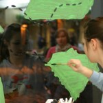 Junior Brooke Meyer decorates the Habitat for Humanity window. Submitted