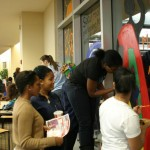 Members of the Pan Afrikan Student Organization (PASO) work together to decorate an Africa Night-themed window. Submitted