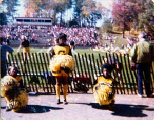 Gustavus cheerleaders cheer at a football game against St. Johns. Gustavus Adolphus College Archives