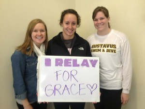 Members of the swim team Senior Amy Beck, Junior Brogan Barr and Sophomore Abby Hinrichs show their support for their teammate. Submitted