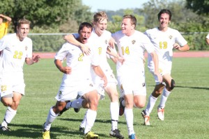 Captain Sean Sendlebach (#2) celebrated with his teammates after scoring the team's only goal in Gustavus' 1-0 victory over conference rival Concordia College. Gustavus Sports Information