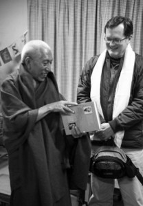 Curtin discusses a gift with former Prime Minister Venerable Samdhong Rinpoche. Submitted