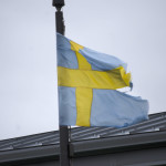The Swedish flag outside of the Swedish house.