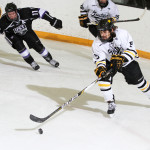 Drew Aspinwall was in charge of the puck against University of Saint Thomas. The Gusties need two out of two wins against Bethel University to secure a spot in the MIAC playoffs.