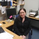 Stacie Miller at her desk in Olin Hall.