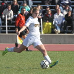 Emily Odermatt kicks the ball up the field. Odermatt has found the net three times this year, which is unusual for a defender. She will play a key part in keeping the young defensive line together when the team travels to Whitewater for the NCAA Regional Tournament this weekend.