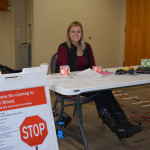 Senior Anna Lundquist volunteers for Communications Club and tables outside Alumni Hall for the Blood Drive.