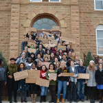 """Students marched from the campus center to the front of Old Main, chanting """"No violence, no hate."""""""