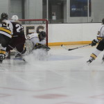 First-year goalie Amanda DiNella covers up an Auggie shot as first-year Laine Fischer and sophomore Laura Johnson watch from their defensive positions. Young players have made a crucial impact this year for the Gusties.