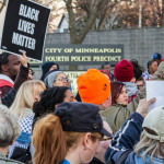 Community and Black Lives Matter activists gather outside the Minneapolis Police Department's 4th precinct in Minneapolis, protesting the officer-involved shooting of Jamar Clark on November 15, 2015.