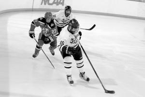 Senior Darren Lapic skates the puck down the ice