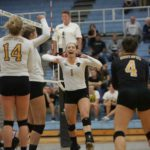 Sophomore Setter Nora Holtan (1) celebrates with her teammates against Bethel. The Gusties went 7-2 in non-conference play and on Wednesday  opened up MIAC play with a 3-2 win over Bethel. The game was a rematch of last year's MIAC Championship game, which the Gusties also won.