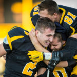 Senior George Buchner Celebrates last-years win against Concordia-Moorhead with teammates. Leadership from seniors such as Buchner and captains Tyler Jakes, Zack Martinez, Jake Schmitz and Joe Theiler will be key as the Gusties attempt to improve on last year's success.