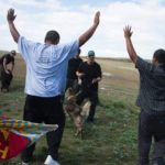 Native people pray while protesting the Dakota Access Pipeline.