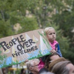 Individuals all over the nation have gotten involved with the Standing Rock movement. While some indivduals will travel to sacride land to protest, others choose to protest in solidarity in various locations as a way of showing their support for the movement. Supporters face various obstacles and challenges in each situation but all keep the same message at heart, 'people before pipelines'.