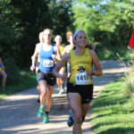 Junior Sarah Anderson competes in the Gustie Invitational. The team looks forward to its next race at the Augsburg Invitational Saturday, Sept. 15.