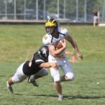 Junior Brayton Finch breaks a tackle during a game against Martin Luther. The Gusties won their first game with a score of 32-20. Finch completed a touchdown and had four receptions in the game.