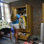 A first year student moves into her room in Norelius hall.