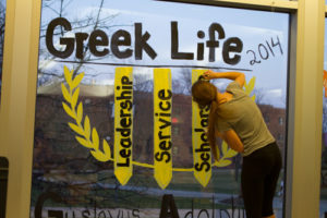 Sororities and fraternities alike participate in window painting.