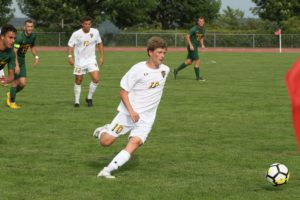 Sophomore Scott Heinen chases after the ball during a game earlier this season.