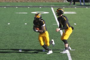 First-year Daavid Peal carries the ball for the Gusties during a game Oct. 20.