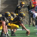 The Gustie offensive line sets up to snap the ball during a game against Augsburg. The team is currently on a four game winning streak heading into their game this Saturday against the Tommies.