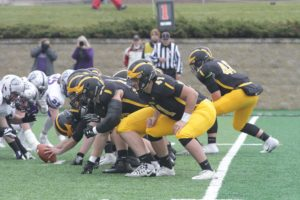 The Gustavus offensive line sets up to snap the ball. The Gusties finished with a 6-4 record.
