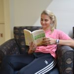 A first-year student spends her afternoon paging through her copy.