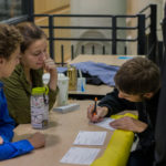 Students tabled outside the Evelyn Young Dining Room to inform students and promote voting.
