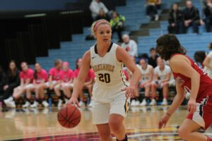 Senior Justine Lee scored her 1,000th point for the Gusties Feb. 16.