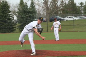Senior Sam Archer warms up on the mound. The team's next competition is against UW-Stout March 16.