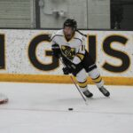 First-year Kayla Vrieze carrries the puck up the ice for the Gusties in a game earlier this season. Vrieze was a first-year standout and named to the MIAC All-Rookie Team this season.
