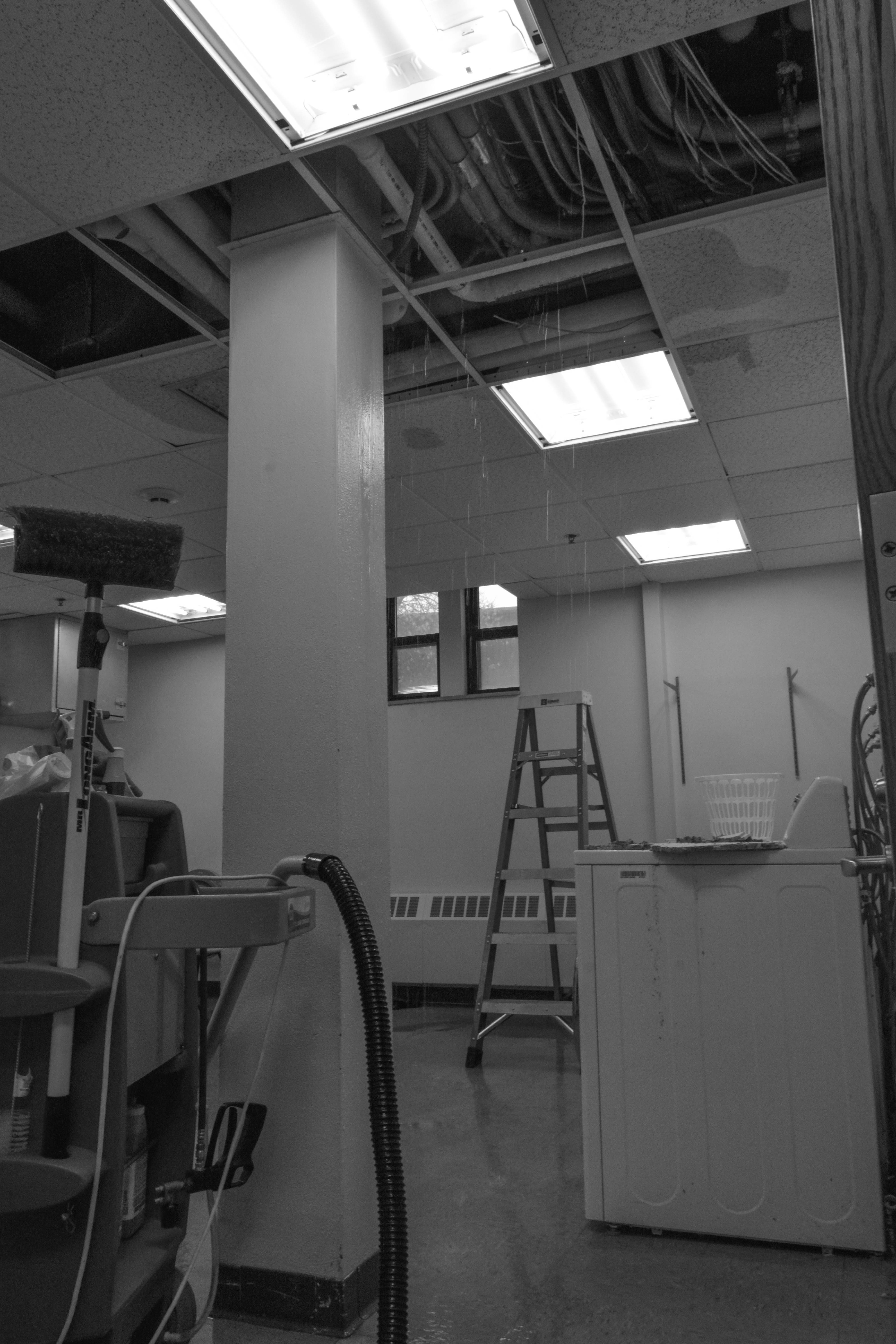 As the snow began melting, water started pouring from the ceiling in the Uhler laundry room.