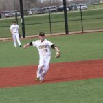 Sophomore Cole Pengilly winds up to throw a ball to first base.