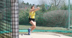 Junior Katie Keelin competets in the hammer throw. The women's team placed first in their most recent meet.