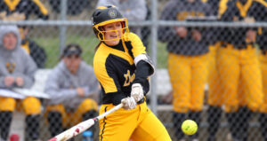 Sophomore Ashley Neuenfeldt swings at a pitch during a game earlier this season. She was the leading hitter for the team with a .351 average.