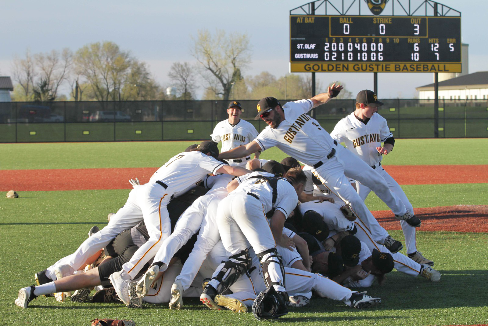 The Gustavus Men's Baseball team celebrates with a dogpile after claiming the title of this year's MIAC championship.