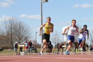 Senior Max Bauer competes in the 200-meter race during a meet this spring.