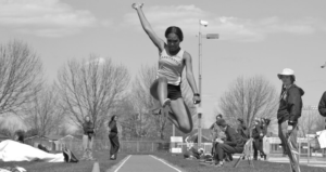 Sophomore Tyra Banks competes in the long jump for the Gusties.