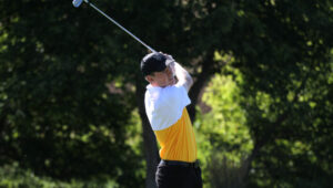 Junior Max Ullan shoots for the green during a match this season.