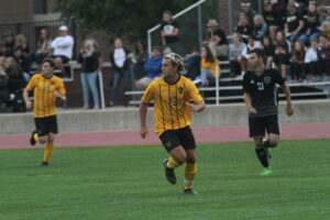 Junior Leo Spry makes a run and prepares for the pass from his teammates.