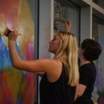As pictured, student organizations paint the windows in the Evelyn Young Dinning Room.