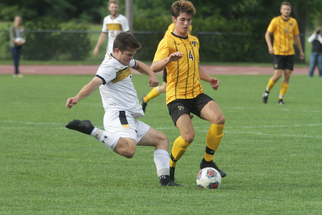 Junior Nolan Garvin prepares to block a cross from a UW-Superior midfielder. The Gusties won the game 5-1 to improve their record to 7-1 overall.