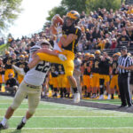 Sophmore Dalton Thelen makes a catch and scores a touchdown for the Gusties during their homecoming game against Bethel University Sept. 28.