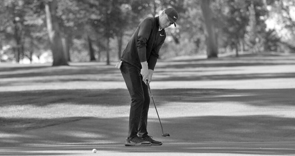 Sophomore Jacob Pedersen attempts to sink the ball during the SJU Fall Invite. Individually, Pederson finished second out of 120 golfers at the invite.