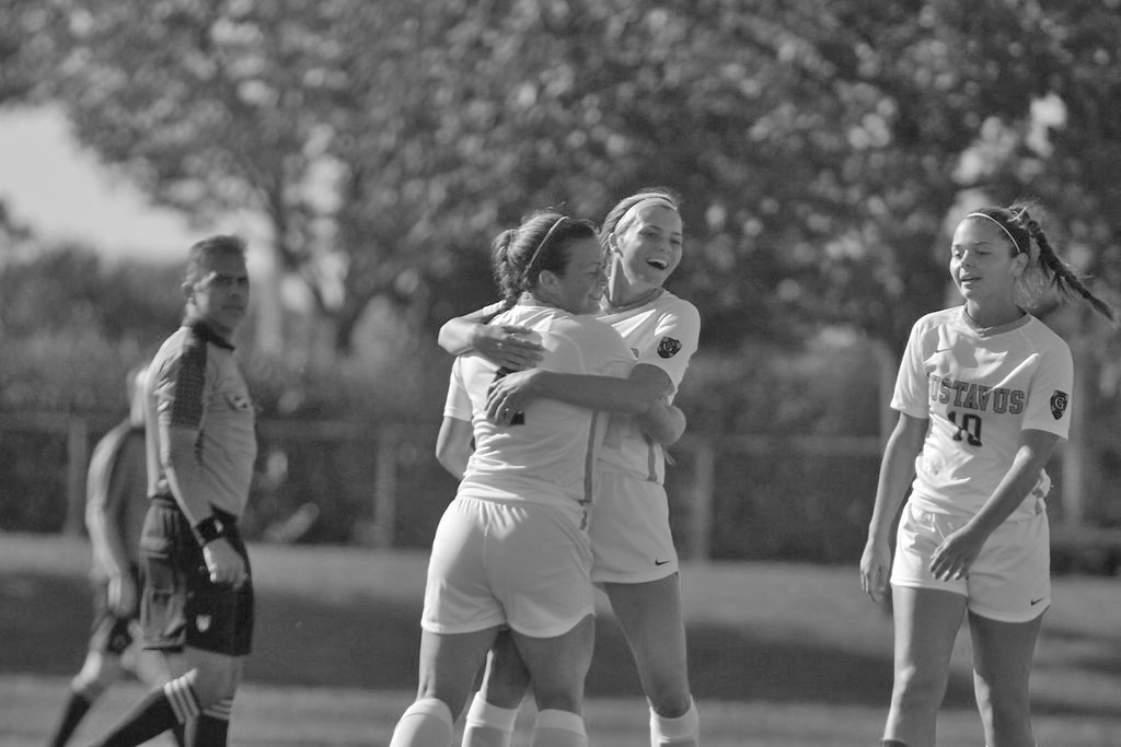 Sophomore Rachel Rehnelt and Senior Abby Mullenbach celebrate a goal during a game against Norwestern University-St. Paul.