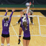 Junior Kate Holtan attempts a kill against two St. Thomas defenders. On Oct. 4, St. Thomas announced it had received an invitation to join the D1 Summit League.